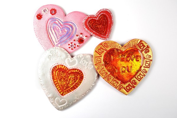 Collection of Valentine Holo Effect Hearts, made from polymer clay.