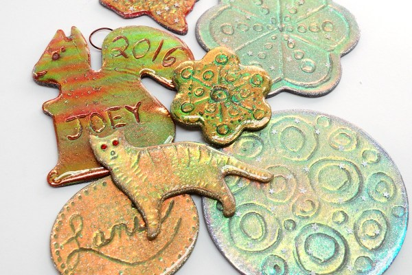 using shaped cutters, make holo cutter ornaments with the holo effect polymer clay tutorial.