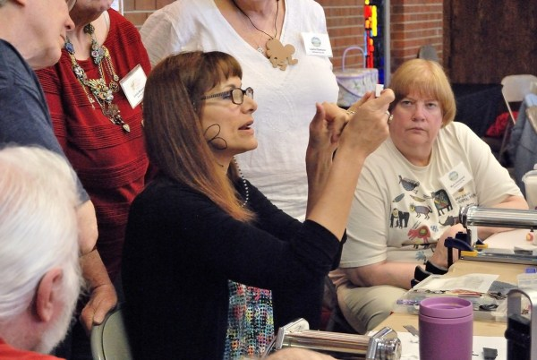 Lisa Pavelka giving an impromptu demo of making a name cane at the 2015 Twisters Poly Clay Retreat in Norman, Oklahoma.