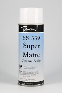 Duncan Super Matte Ceramic Sealer is possibly safe on polymer clay.