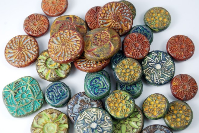 You can create rustic beads in rich colors using the Rustic Beads in Polymer Clay Tutorial by The Blue Bottle Tree.