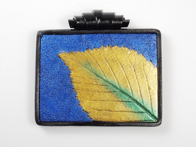 Mica Leaf Pendant using texture to disguise bumps in the background of the polymer clay.