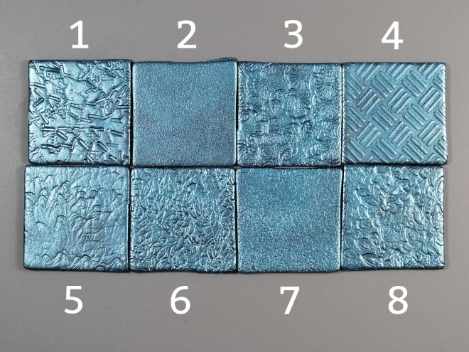 Various stamps create a fine texture on polymer clay to disguise fingerprints and marks.