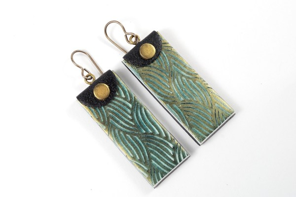 Polymer clay earrings made with Kor roller texture rollers.