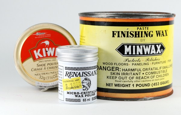 Waxes can sometimes be used to create a glossy coating on polymer clay.