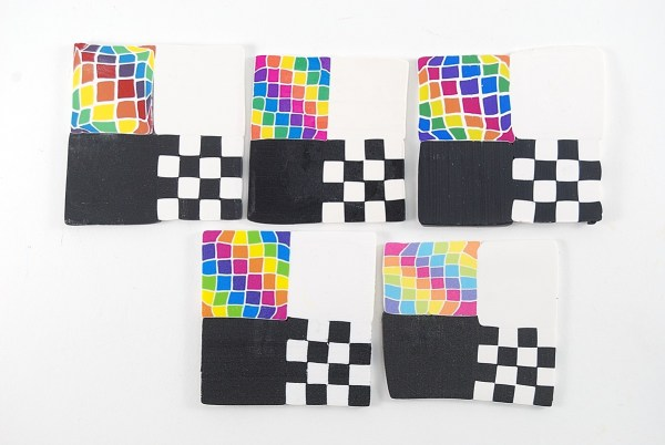 Test tiles were made from five brands of clay to use as the base for testing polymer clay sealers.