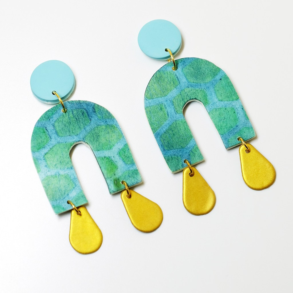 polymer clay earrings with arch shape and gold teardrops
