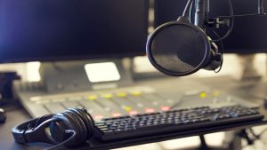 Mike Grimes, Microphone and headset in radio station broadcasting studio