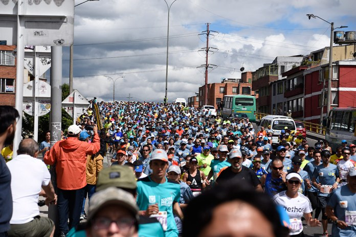 Thousands of runners fill the street in last year's Bogotá half marathon