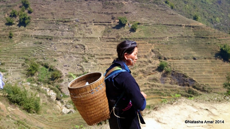 A Black Hmong woman working as a trekking guide