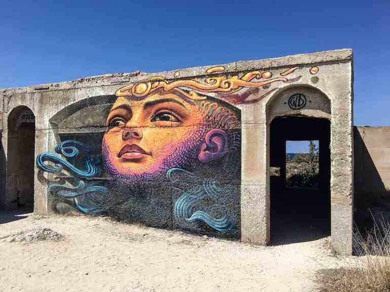 Graffiti in Aliko Beach: Enjoy a slice of island paradise on the best Naxos beaches in the popular Cyclades islands in Greece. From sandy beaches with crystal waters and secret coves for privacy, these are the best beaches in Naxos.