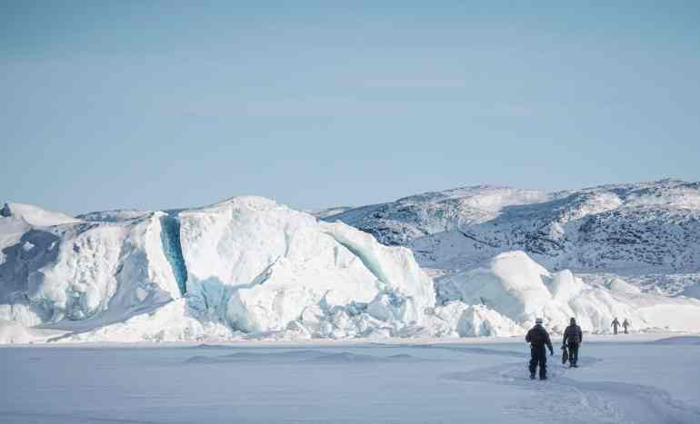icebergs in a frozen fiord in Greenland
