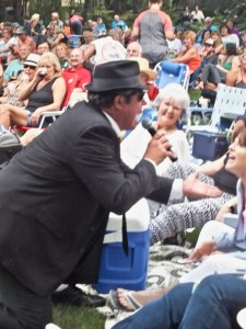 Elwood singing to woman in crowd at the show