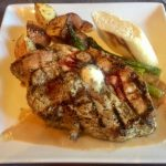 A delicious grilled pork chop at Kahootz
