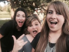 Carrie, Jara, and Isabel show their excitement because Isabel is going to be interviewed by Justine Magazine!