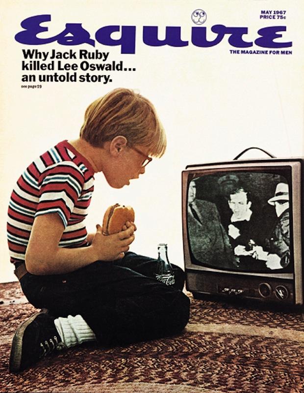 1960s American child watching TV eating a hamburger