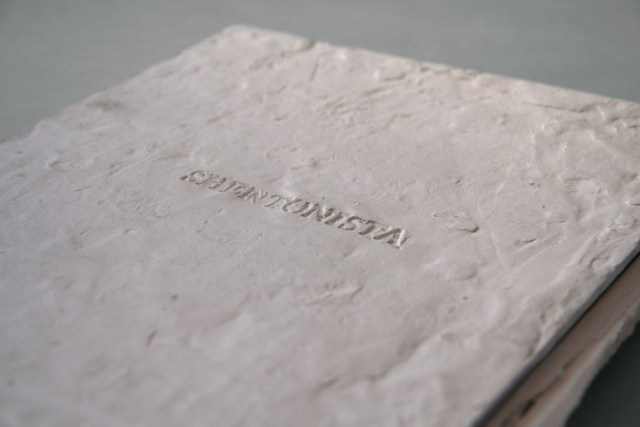 A book with a clay cover