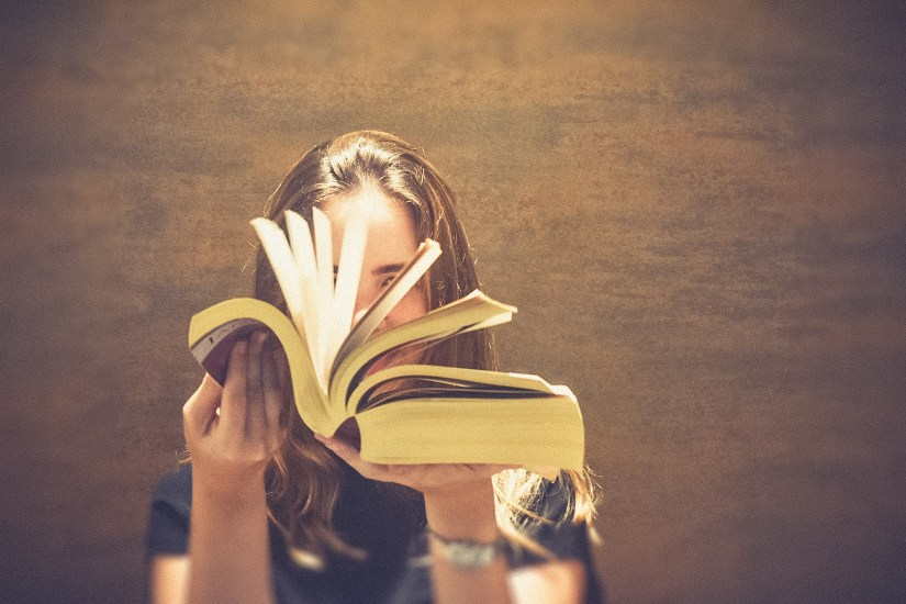 Girl holding an open book