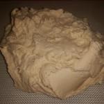 Very sticky dough on a mat.