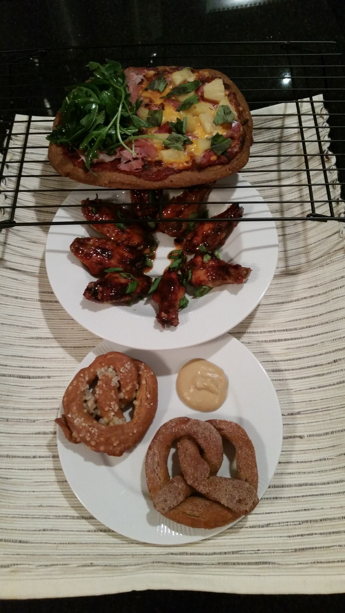 Display of GF Pizza, wings, and pretzels