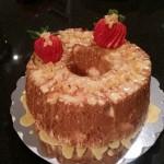 Angel Food Cake with orange-lemon glaze, candied orange peel, and sliced strawberries
