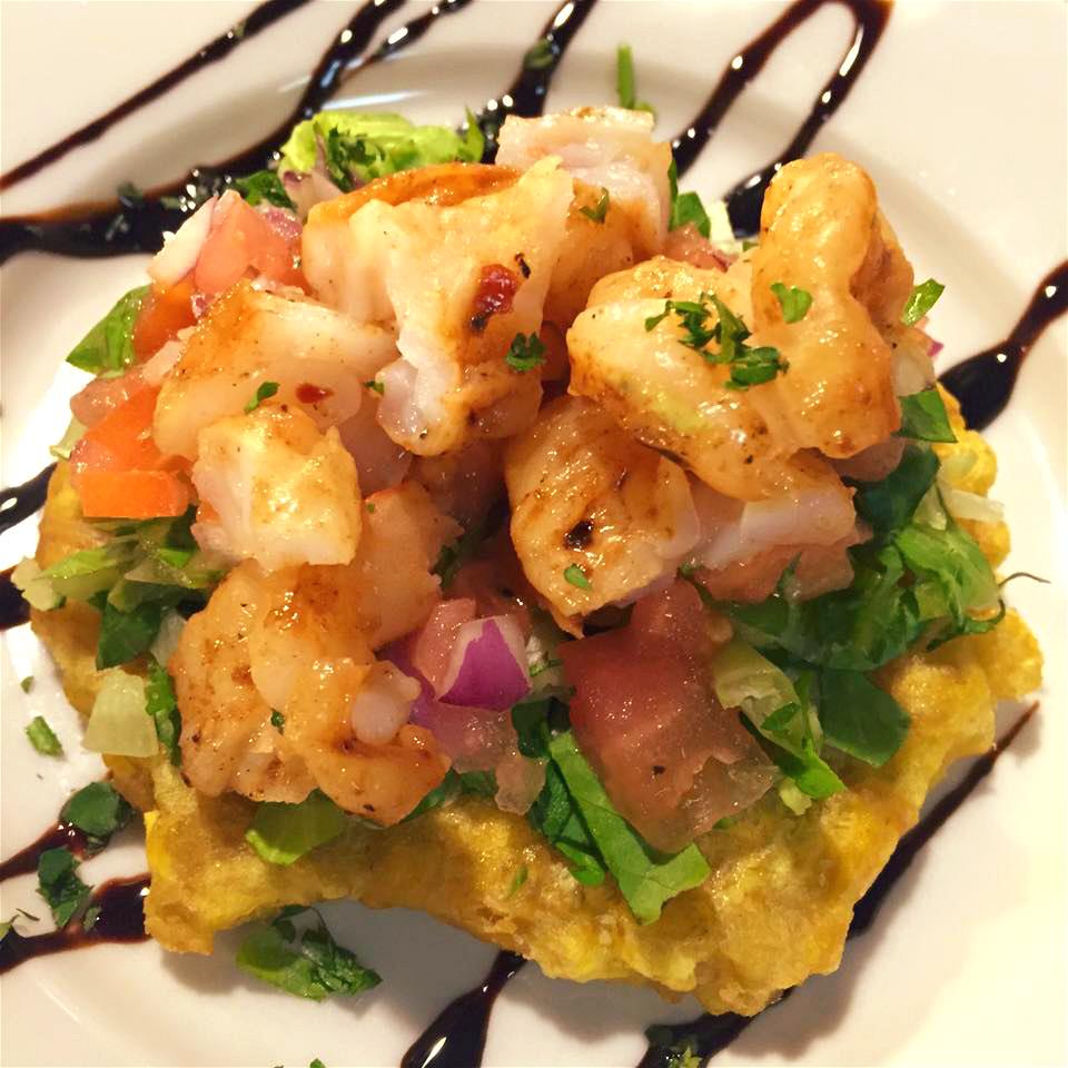 Tostones con Camarones: green plantain topped with bruschetta & mojo shrimp