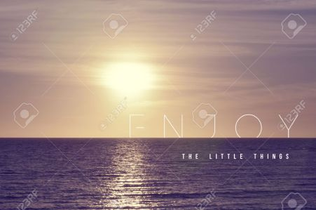 38898447-Enjoy-the-little-things-motivational-inspiring-quote-concept-with-soft-light-summer-sunset-landscape-Stock-Photo