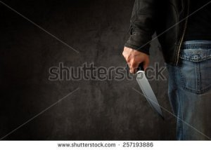 stock-photo-evil-criminal-with-large-sharp-knife-ready-for-robbery-or-to-commit-a-homicide-257193886