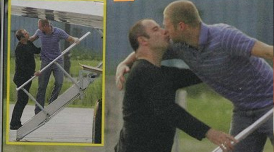 Gay Travolta kissing a guy