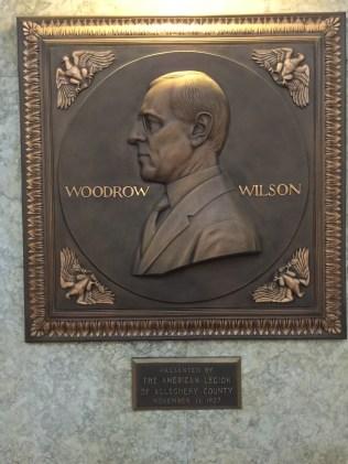 Shrieking head of Demonic racist Wilson with genocidal Versailles Treaty