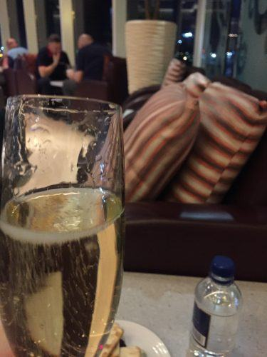 glass of champagne in lounge at heathrow terminal 4 for malaysia airlines business class