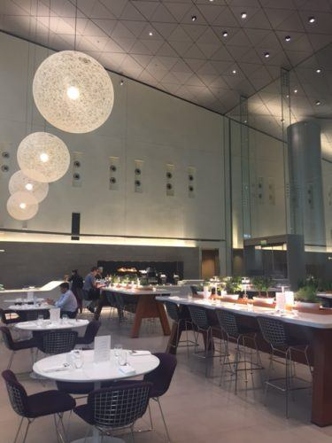 modern restaurant with high ceiling qatar airways business class lounge doha airport