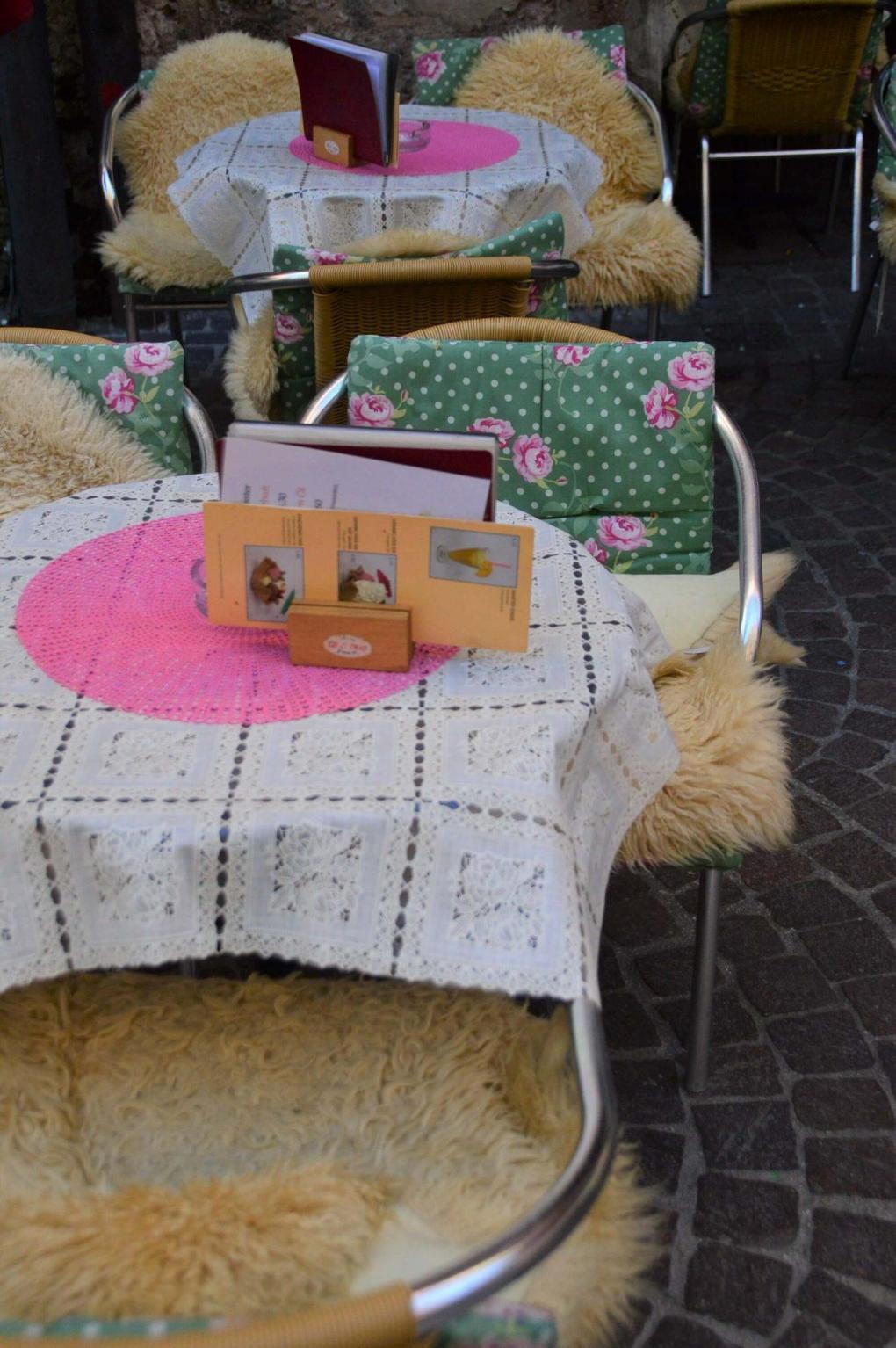 chairs and tables with wooly and colourful rugs and cusshions innsbruck