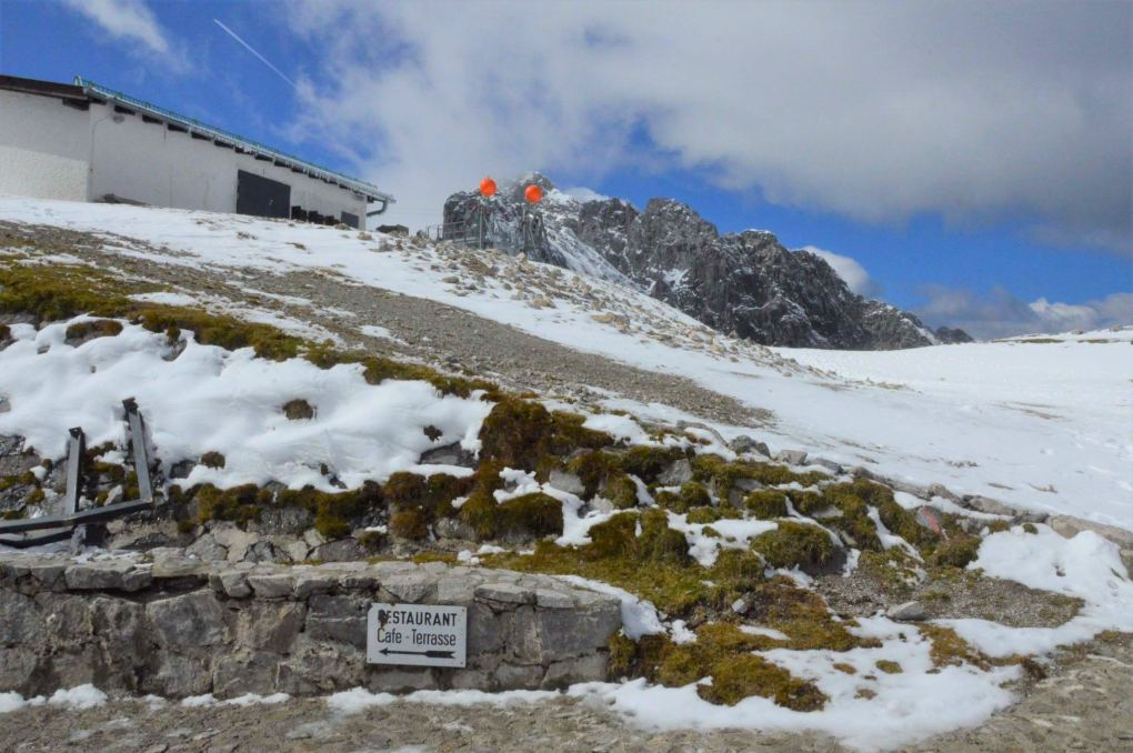 snow and rocks at the top of the nordkette cable car innsbruck