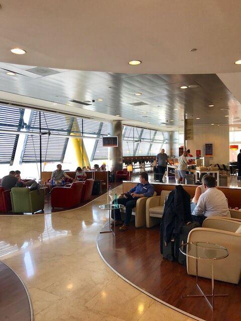 seats and corridor at british airways business class lounge heathrow terminal 5