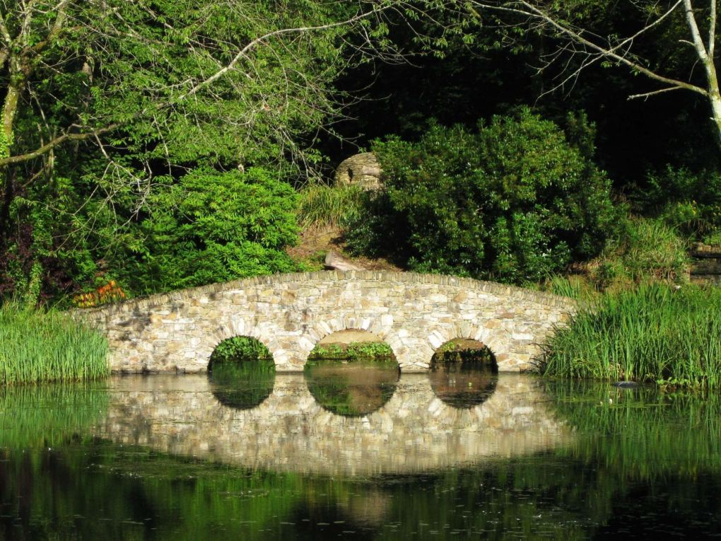 bridge reflected in lake monart spa ireland