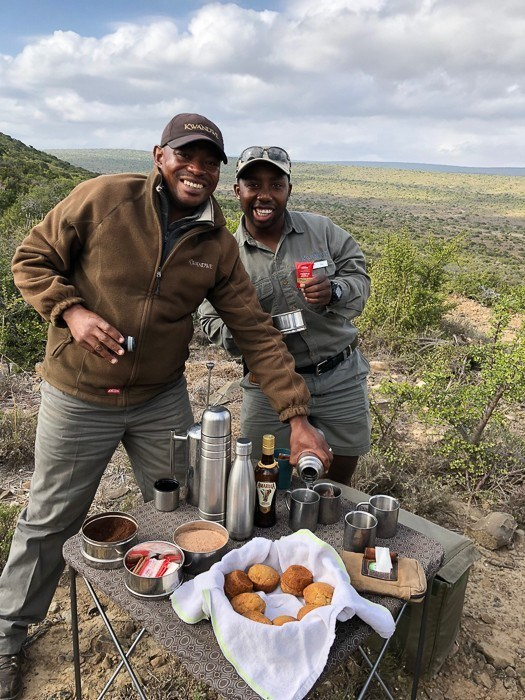 two safari guides at kwandwe with a table and coffee and food