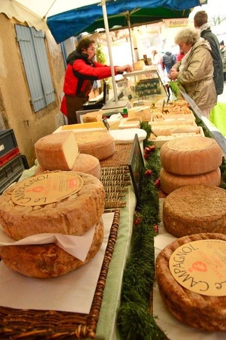 saint antonin market wheels of cheese