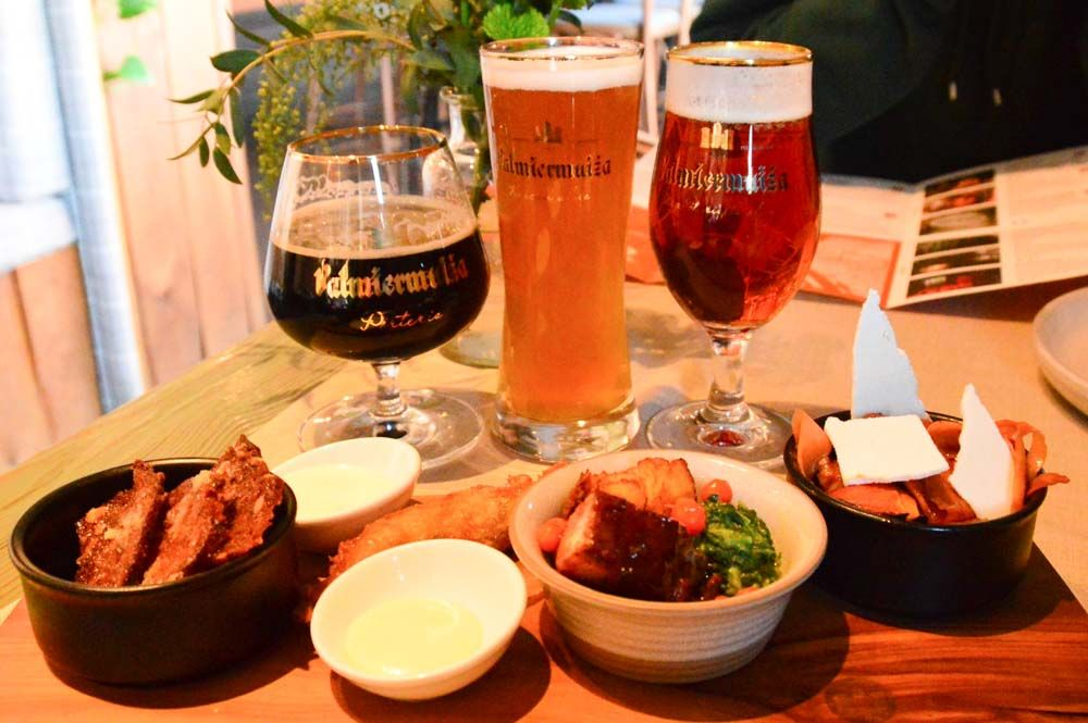 beers and bar snacks on the riga beer district tour