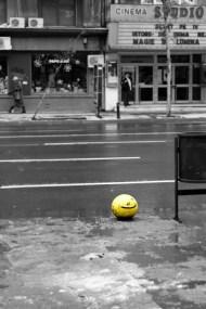 Yellow smiley on street