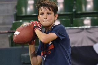 Jack-Brady-mimics-All-Pro-dad-Tom-Brady-at-Asian-football-camp