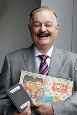 John Peddie holds the first Australian LEGO set and his passport from 1962