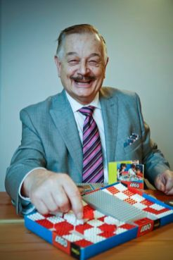 John Peddie plays with the first LEGO set brought to Australia in 1962