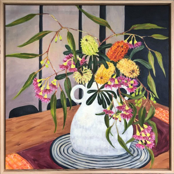 Oil painting depicting a white vase sitting on a black and white striped placemat, on a wooden table, holding a bouquet of native Australian flowers.