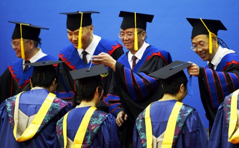 File photo: Educators turn the tassels for graduates at Zhejiang University, China [Xinhua]