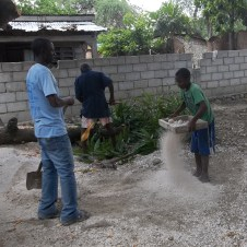 One of the boys sifted dirt...