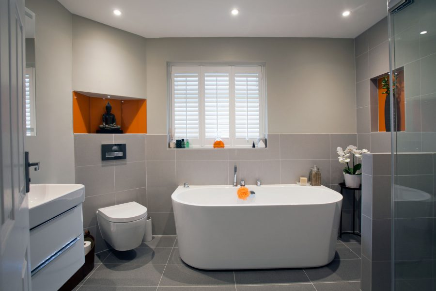 Modern, minimal main bathroom with orange accents ... on Main Bathroom Ideas  id=71016