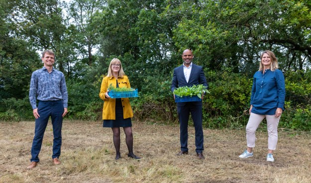Mayor Marvin Rees at Eastwood Farm in Brislington, with Councillor Nicola Beech, to launch Bristol's Ecological Emergency Action Plan. Marvin and Nicola are holding vegetable boxes, smiling alongside Lisa Jones, Head of Communities and Engagement at Avon Wildlife Trust, and Stuart Gardner, West of England Nature Partnership (WENP) Manager.