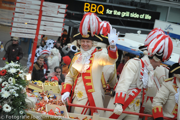 Princes giving out gifts at the Cologne Carnival, 2014.