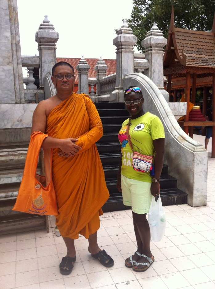 The Asian lifestyle with a Buddhist monk in Bangkok! Can you see what's different?